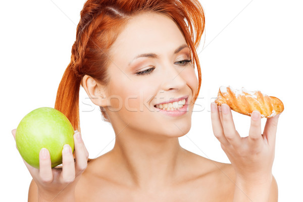 pretty woman with apple and cake Stock photo © dolgachov