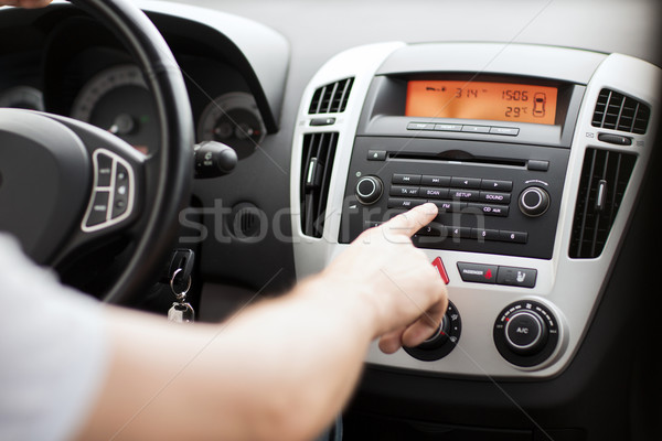man using car audio stereo system Stock photo © dolgachov