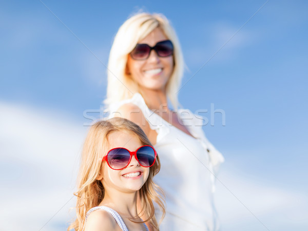 mother and child in sunglasses Stock photo © dolgachov
