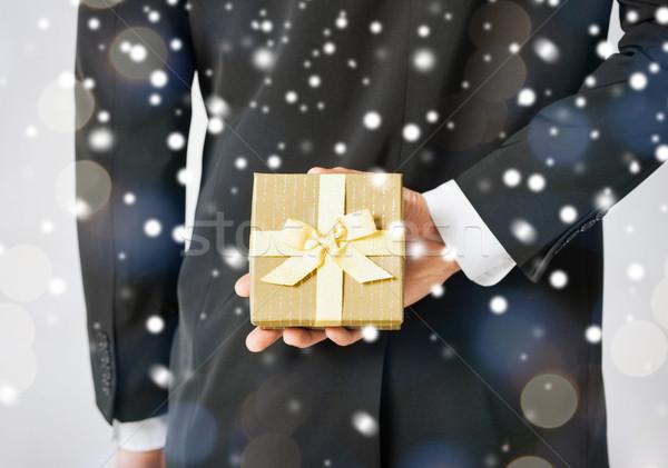 man hiding gift box Stock photo © dolgachov