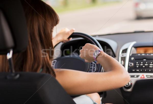 Kadın sürücü araba bakıyor izlemek taşımacılık Stok fotoğraf © dolgachov