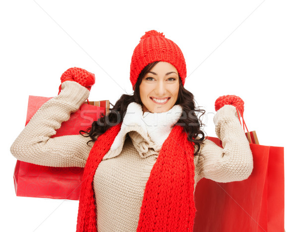 smiling woman in warm clothers with shopping bags Stock photo © dolgachov