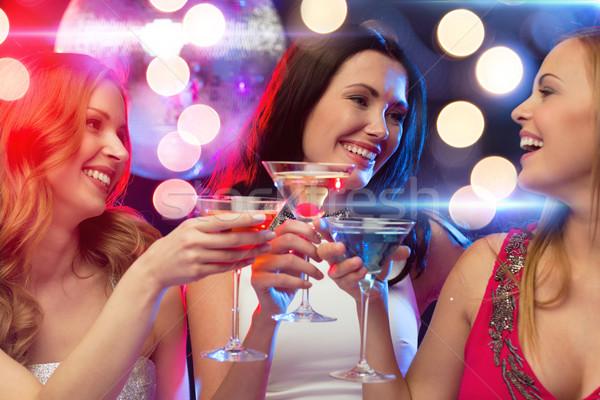 три улыбаясь женщины коктейли Disco Ball Новый год Сток-фото © dolgachov
