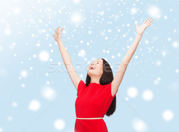 smiling young woman in red dress waving hands Stock photo © dolgachov