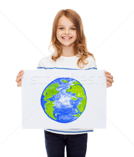 smiling little child holding picture of planet Stock photo © dolgachov