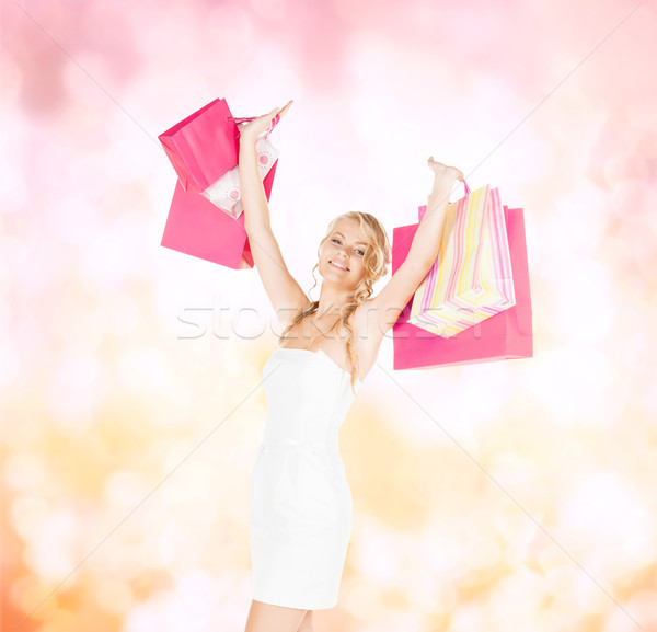 woman with shopping bags in dress and high heels Stock photo © dolgachov