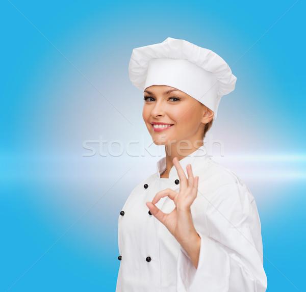 Stock fotó: Mosolyog · női · szakács · mutat · ok · kézjel