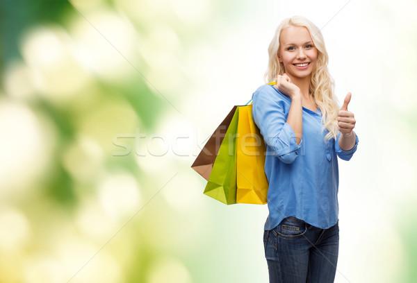 Gülümseyen kadın perakende jest Stok fotoğraf © dolgachov