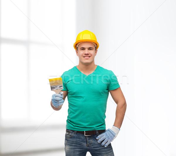 Sorridente manual trabalhador capacete pincel reparar Foto stock © dolgachov