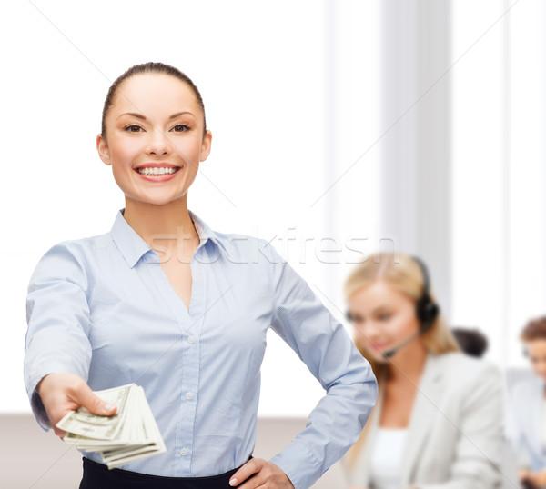 Jeunes femme d'affaires dollar trésorerie argent affaires Photo stock © dolgachov