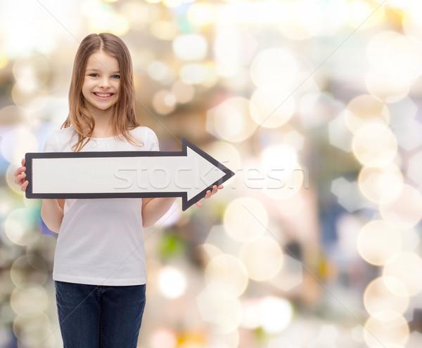 ストックフォト: 笑みを浮かべて · 少女 · 矢印 · ポインティング · 右 · 広告