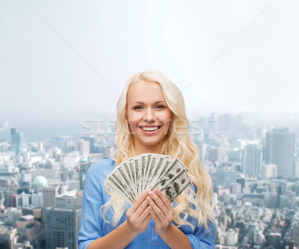 smiling young woman with us dollar money Stock photo © dolgachov