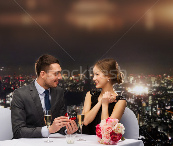 man proposing to his girlfriend at restaurant Stock photo © dolgachov