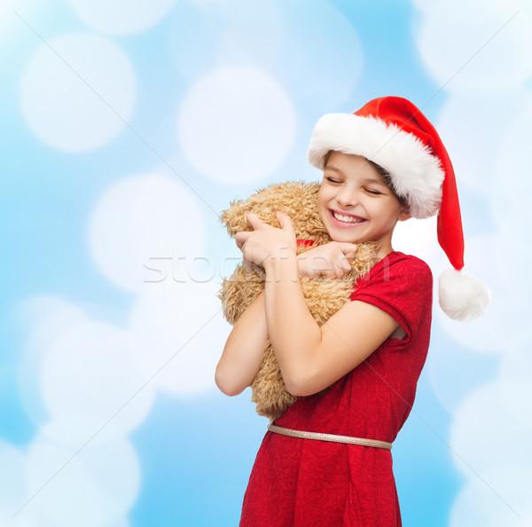 Stok fotoğraf: Gülen · kız · yardımcı · şapka · oyuncak · ayı