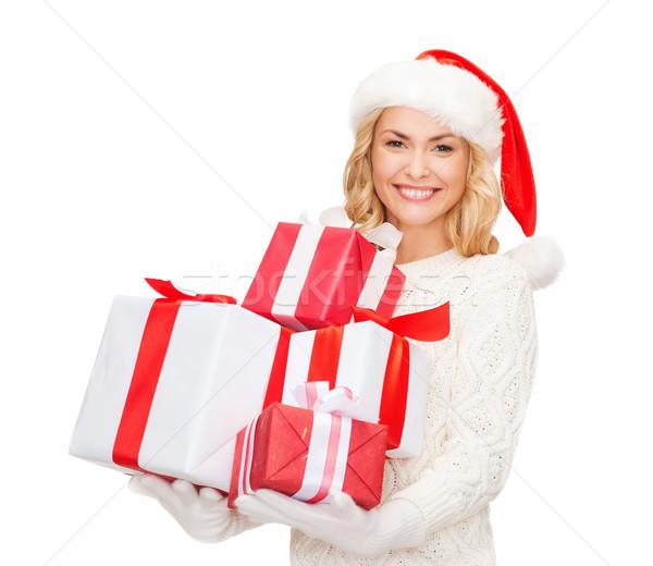 Mulher ajudante seis muitos caixas de presente Foto stock © dolgachov