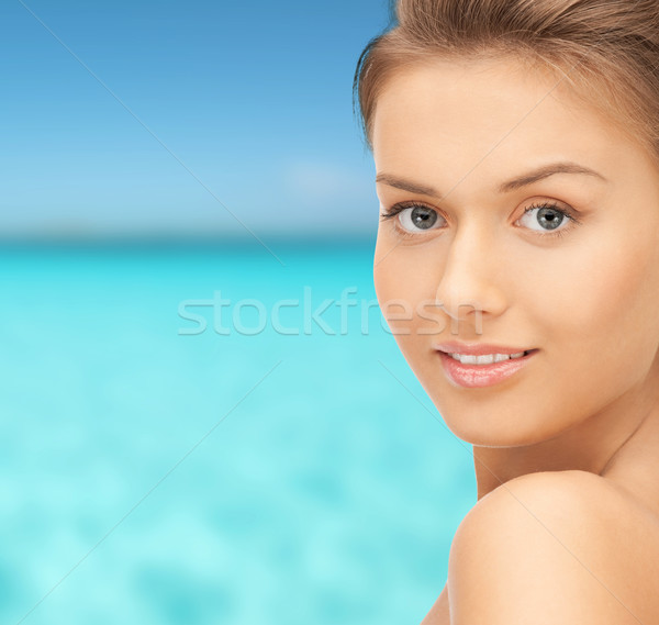 beautiful young woman over blue sky and sea Stock photo © dolgachov