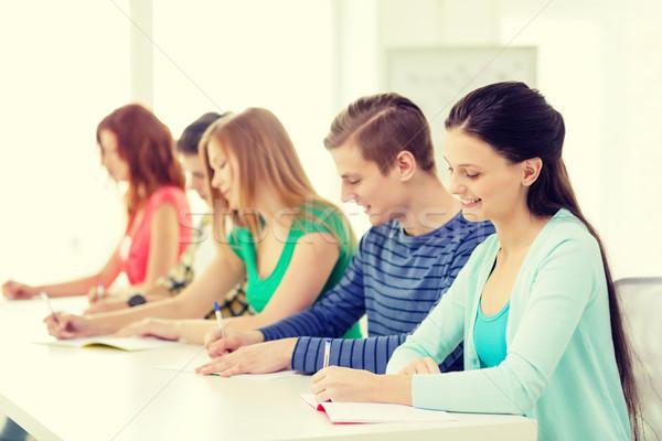 Mosolyog diákok tankönyvek iskola oktatás öt Stock fotó © dolgachov