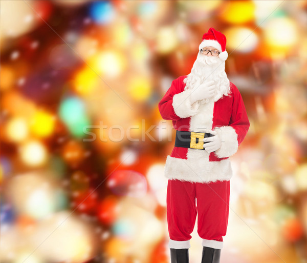 man in costume of santa claus Stock photo © dolgachov