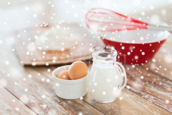 Közelkép tejesflakon tojások habaró liszt főzés Stock fotó © dolgachov