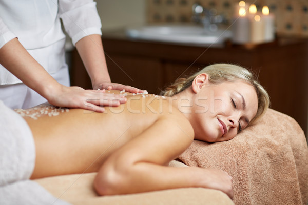 close up of woman lying and having massage in spa Stock photo © dolgachov