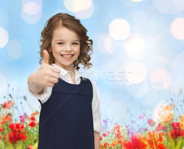 Boldog kicsi iskolás lány mutat remek emberek Stock fotó © dolgachov