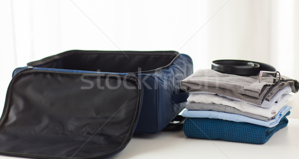 close up of business travel bag and clothes Stock fotó © dolgachov