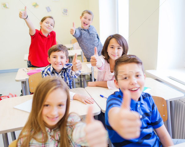 group of school kids showing thumbs up Stock photo © dolgachov