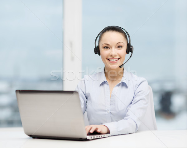 Stock photo: friendly female helpline operator