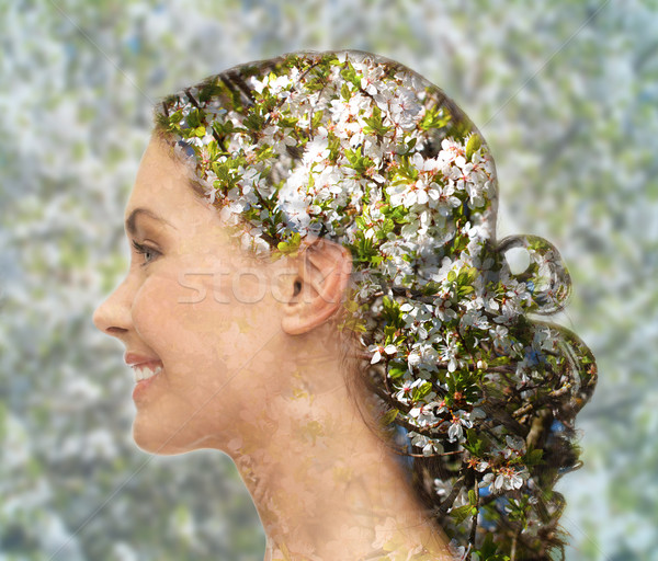 Stock photo: happy woman face over blooming tree pattern