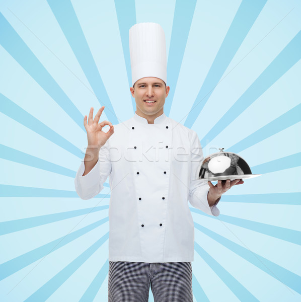happy male chef cook with cloche showing ok sign Stock photo © dolgachov