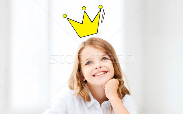 Mosolyog kicsi iskolás lány korona oktatás gyermekkor Stock fotó © dolgachov