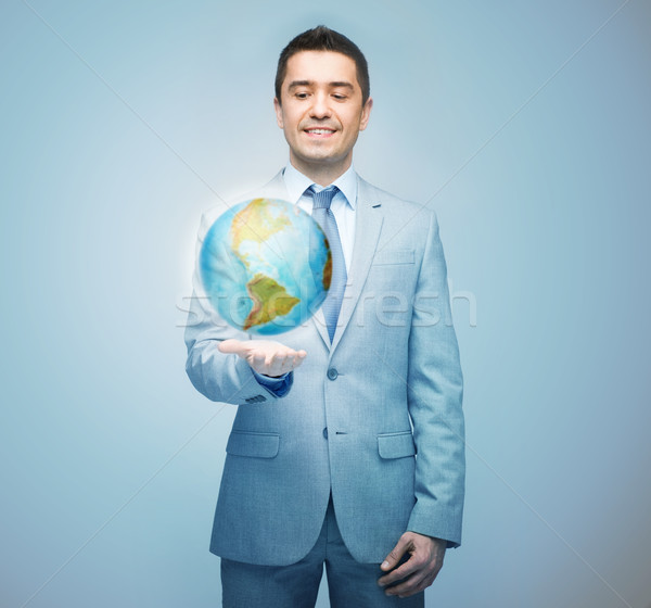 Foto stock: Feliz · empresário · terno · globo · holograma