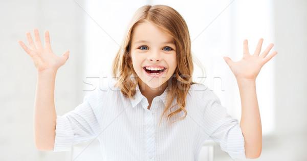 Surpreendido risonho menina as mãos levantadas educação escolas Foto stock © dolgachov