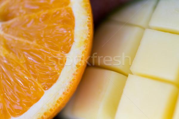 Frescos jugoso naranja mango rebanadas Foto stock © dolgachov