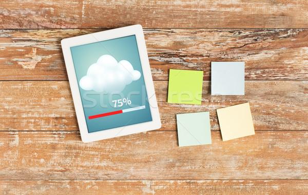 stickers and tablet pc transferring data Stock photo © dolgachov