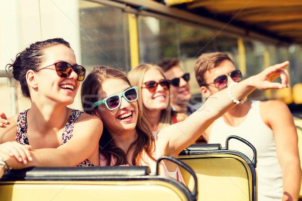 Grup gülen arkadaşlar tur otobüs Stok fotoğraf © dolgachov