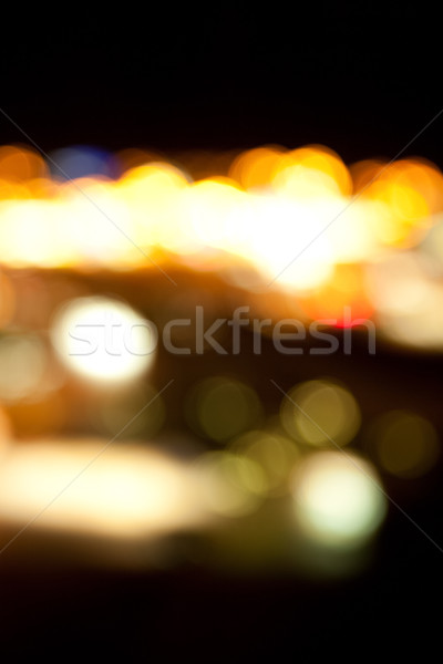 golden bright lights on dark night background Stock photo © dolgachov
