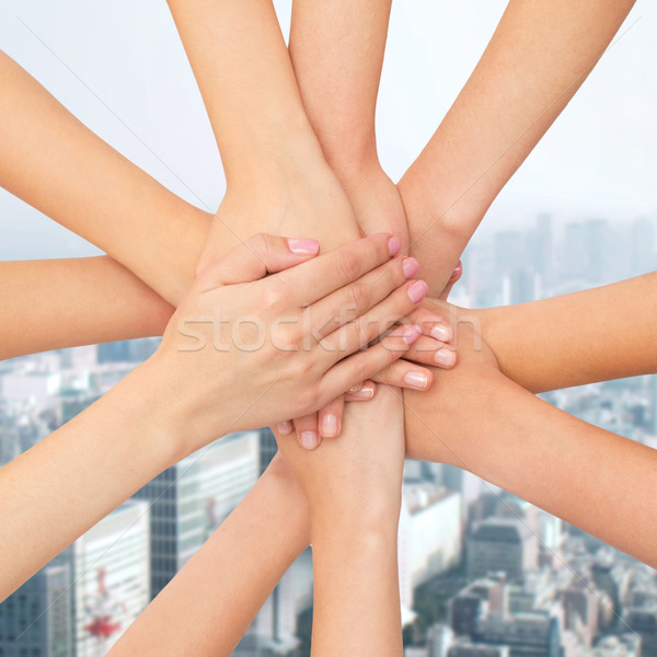 close up of hands on top Stock photo © dolgachov