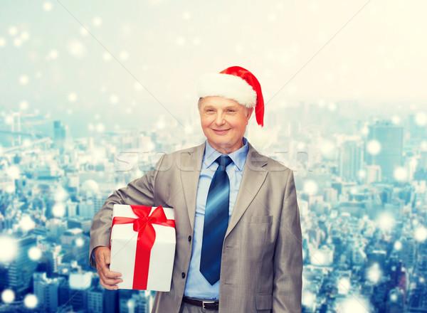 笑みを浮かべて 男 スーツ サンタクロース ヘルパー 帽子 ストックフォト © dolgachov