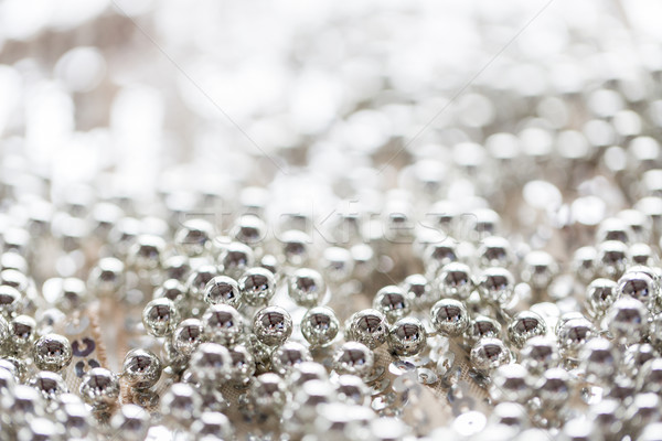 close up of silver beads on shiny sequined texture Stock photo © dolgachov