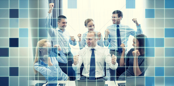 business people celebrating victory in office Stock photo © dolgachov
