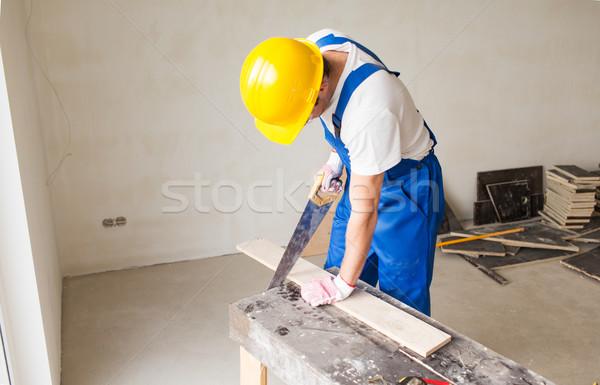 Builder braccio visto bordo costruzione Foto d'archivio © dolgachov