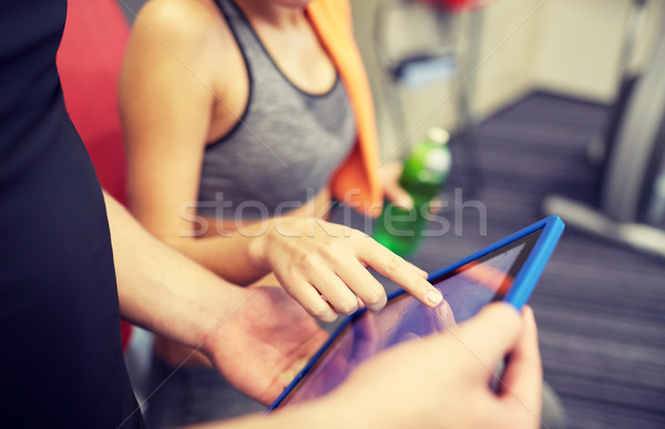 close up of trainer hands with tablet pc in gym Stock photo © dolgachov