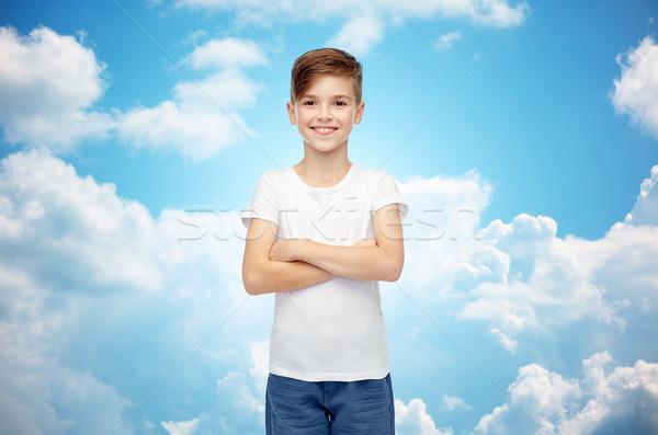happy boy in white t-shirt and jeans Stock photo © dolgachov