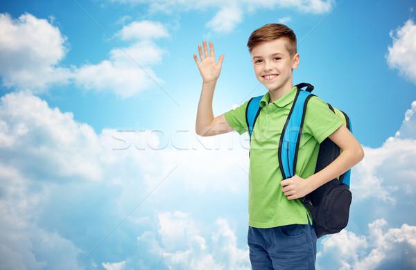happy student boy with school bag waving hand Stock photo © dolgachov