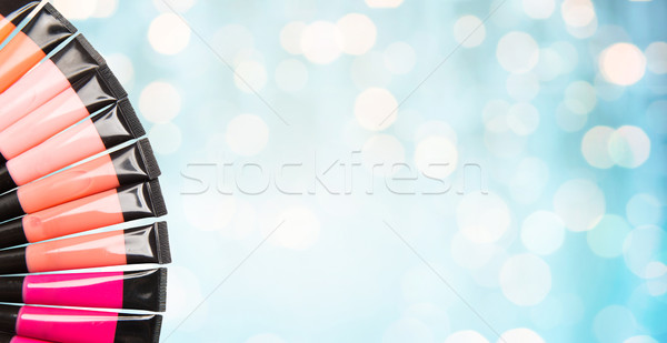 close up of lip gloss tubes over blue lights Stock photo © dolgachov