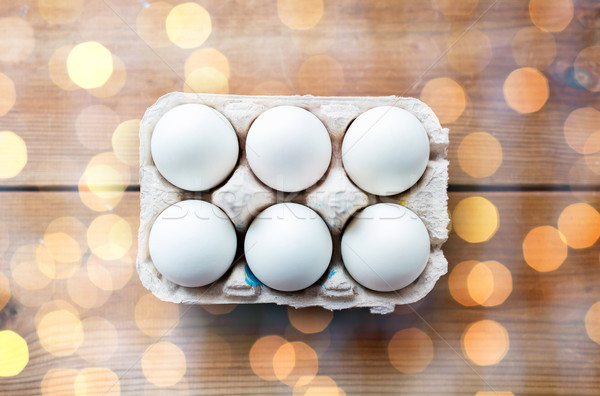 close up of white eggs in egg box or carton Stock photo © dolgachov