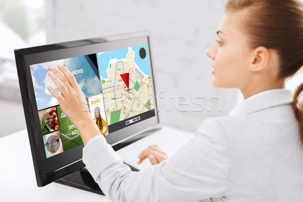 businesswoman with computer touchscreen in office Stock photo © dolgachov