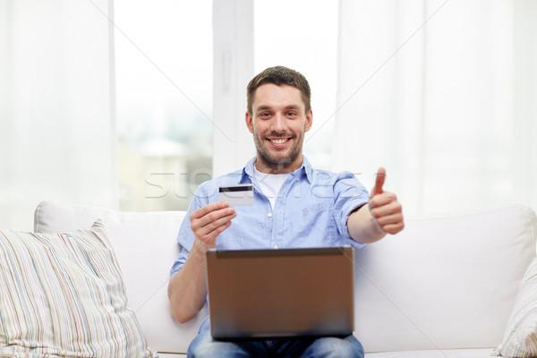 Mann Laptop Kreditkarte Technologie Stock foto © dolgachov