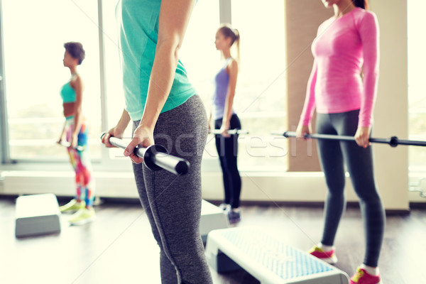 close up of women exercising with bars in gym Stock photo © dolgachov